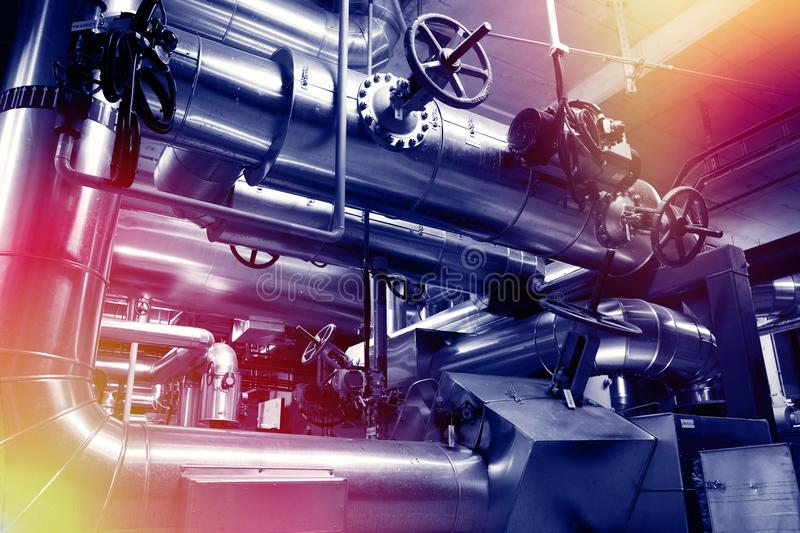 Industrial pipelines, valves, cables and walkways royalty free stock photo