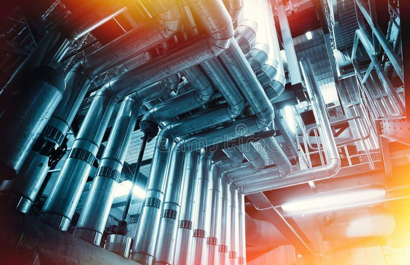 Industrial Steel pipelines, valves and ladders royalty free stock photography