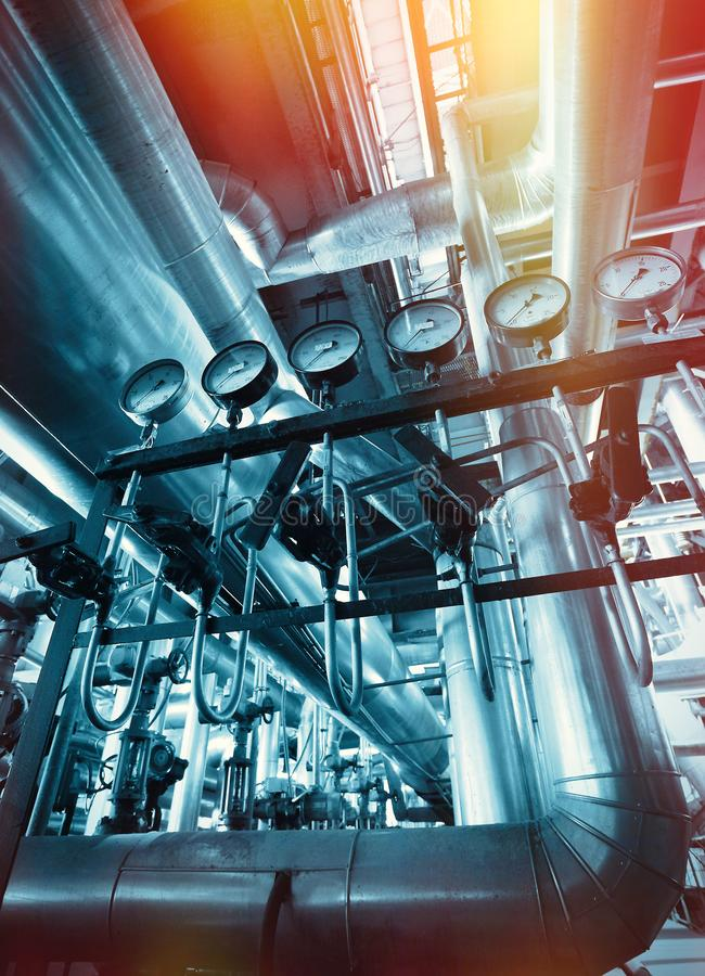 Industrial Steel pipelines, valves and ladders stock photo