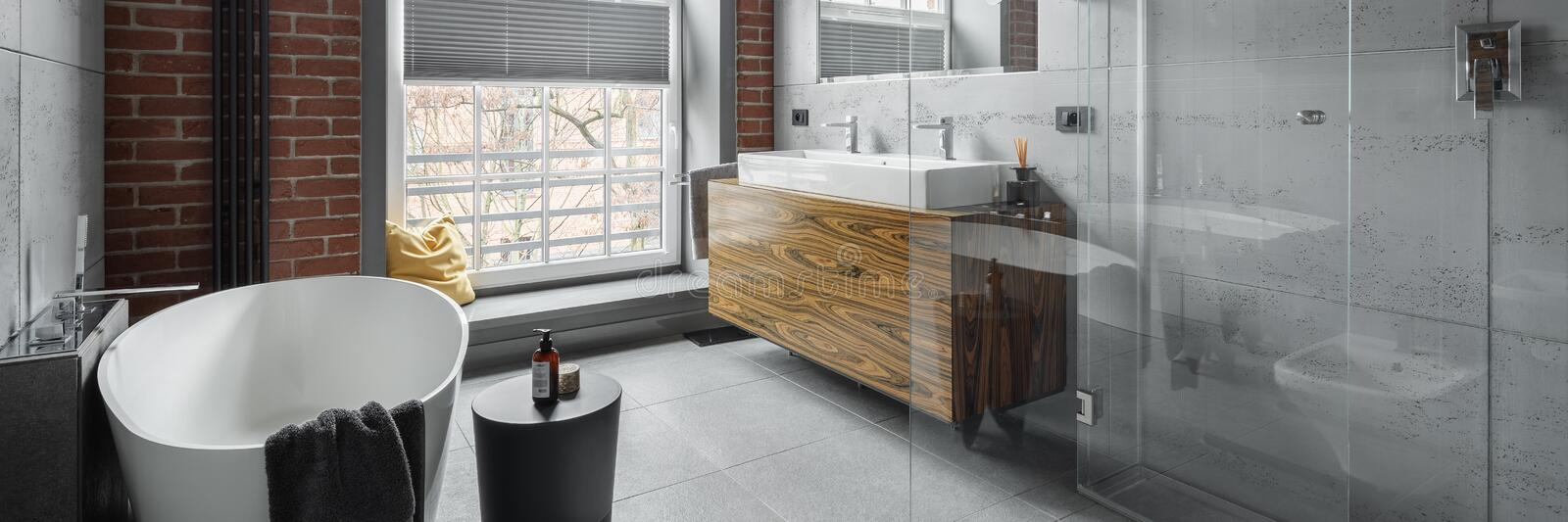 Industrial style big bathroom, panorama royalty free stock photos