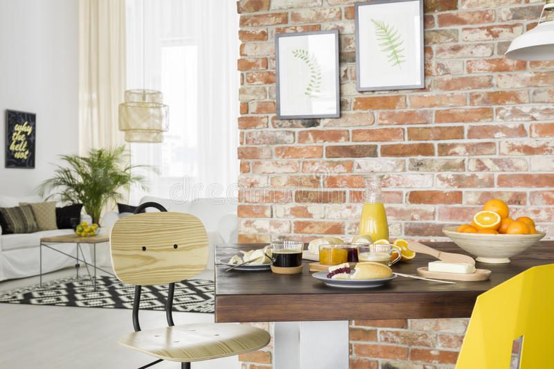 Industrial style dining room. With wood table and chair stock images