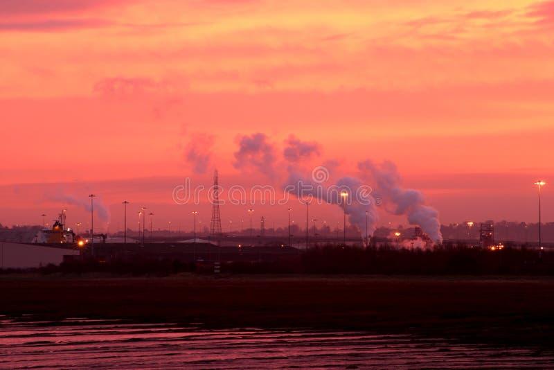 Download Industrial Sunrise stock photo. Image of golden, chimney - 48292