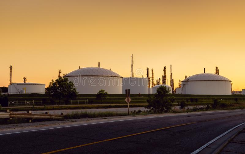 Industrial tank farm at sunset royalty free stock photos