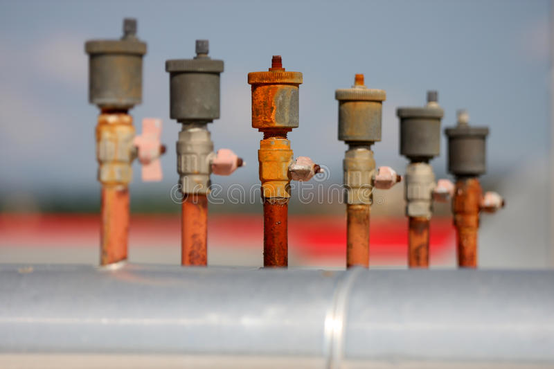 Industrial Taps. Series / Blurred Background / Focus on the Center stock images