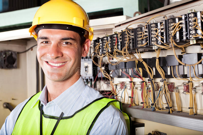 Industrial technician. Portrait of male caucasian industrial technician royalty free stock photography