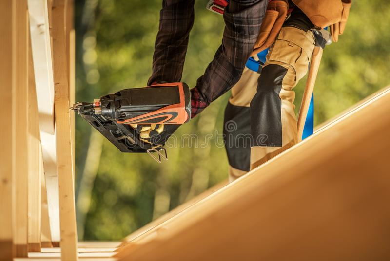 Worker with Nail Gun stock images