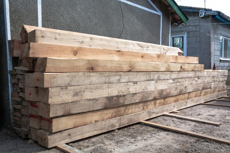 Industrial timber building materials for carpentry, building, repairing and furniture, lumber material for roofing construction. stock photos
