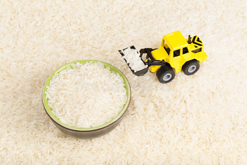 Industrial tractor toy load rice seeds to plate
