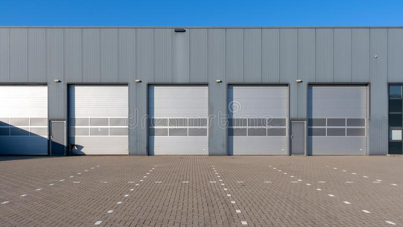 Industrial Unit with roller shutter doors royalty free stock image
