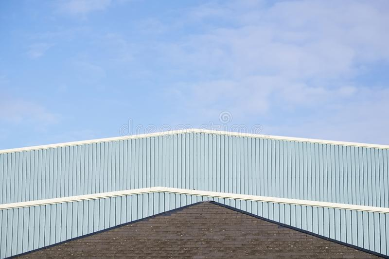 Industrial unit roof corrugated metal straight design against blue sky royalty free stock photography