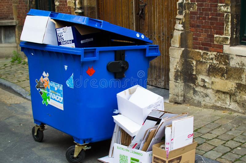 Industrial urban city street with trash and garbage dumpsters in Ghent, Belgium, Europe.  stock images