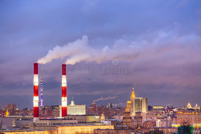 Industrial urban cityscape. Factory pipes of a city landscape in Moscow, Russia during sunset. stock photo