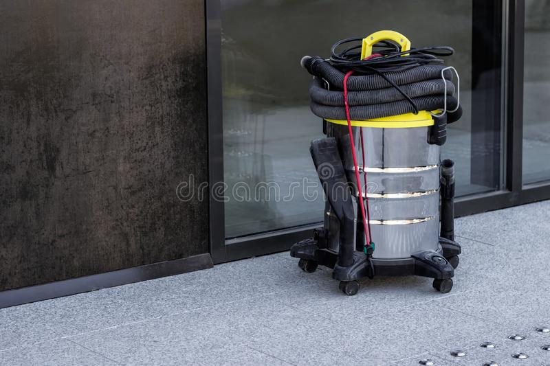 Industrial vacuum cleaner in urban environment. stock photography