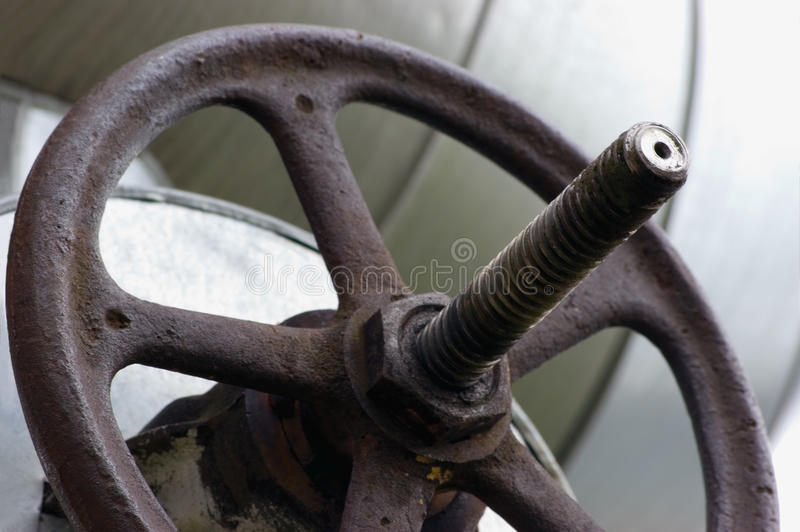 Industrial Valve Wheel Stem, Heating Main Pipeline Pipes, Old Aged Weathered Grunge Closeup stock image