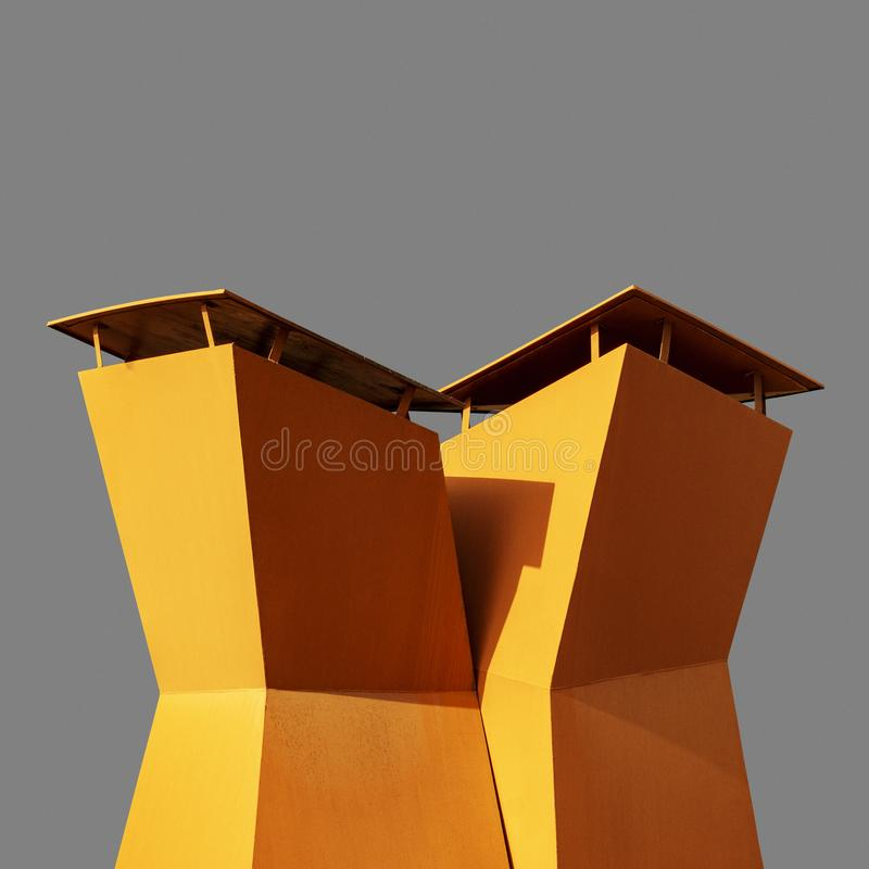 Industrial geometric vent chimney detail  on gray background stock image