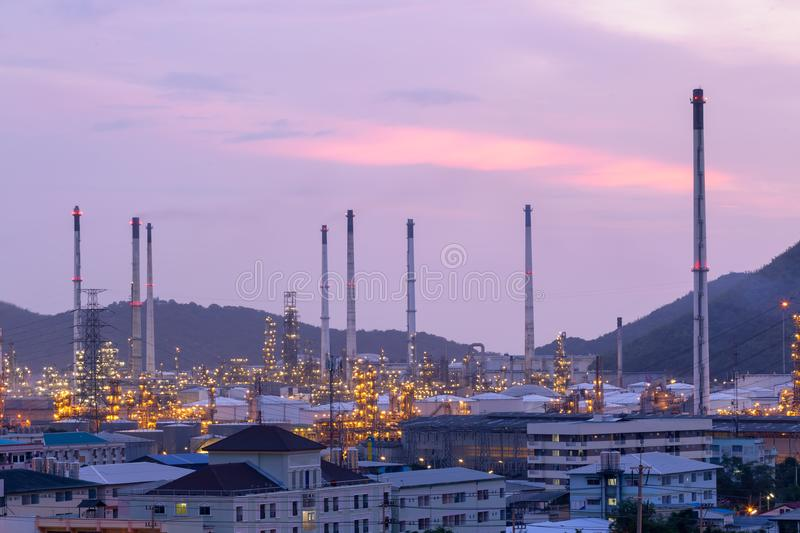 Industrial view at oil refinery plant form industry zone with sunset and cloudy sky royalty free stock photos