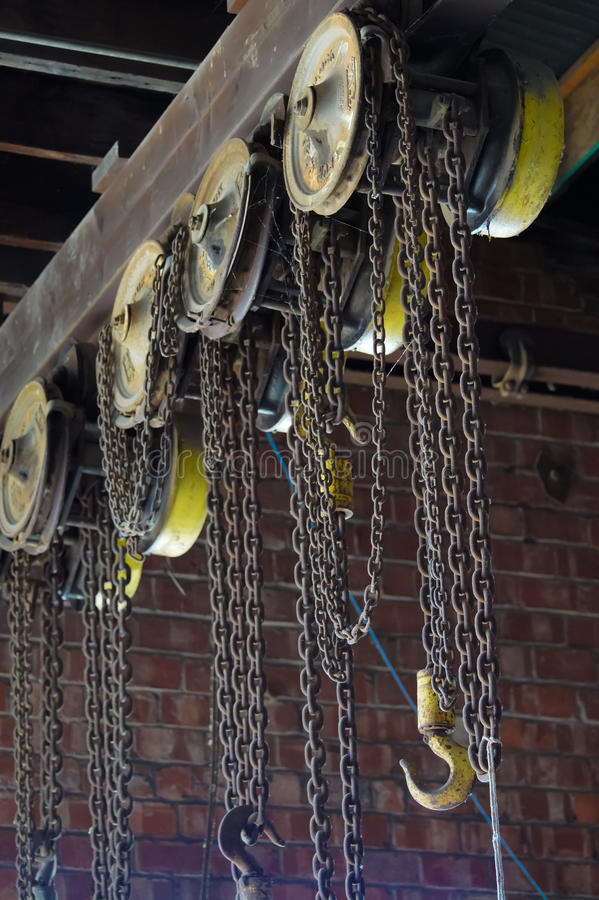 Industrial warehouse hook and chains royalty free stock photography