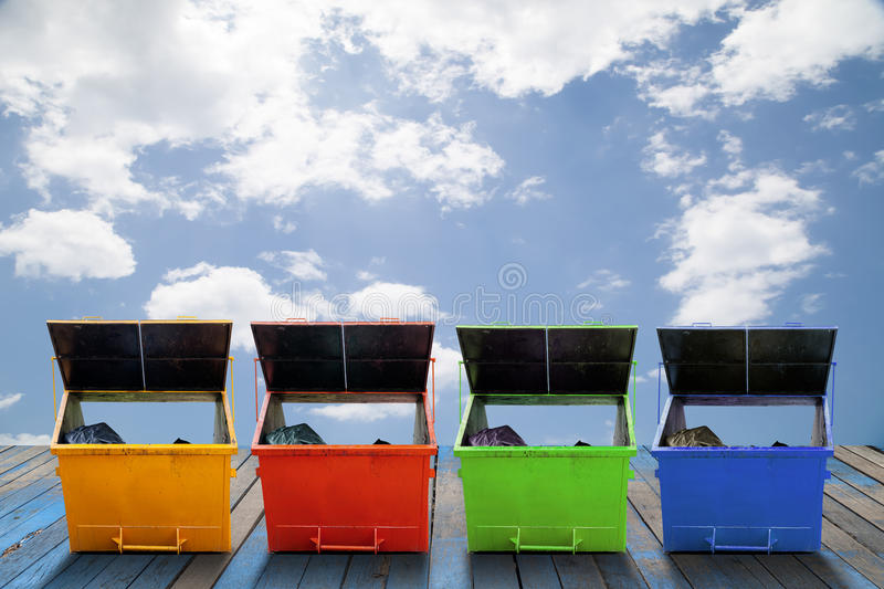 Industrial Waste Bin (dumpster) for municipal waste or industrial waste, on wood and sky background. stock photography