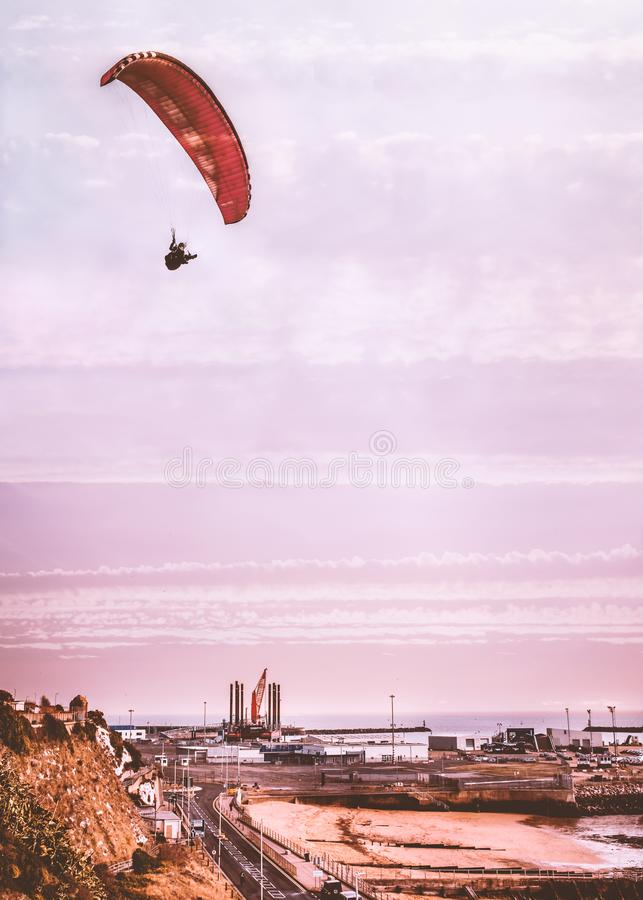 The industrial west cliff side of Ramsgate royal harbour, Kent, UK as a paraglider flies overhead stock photos