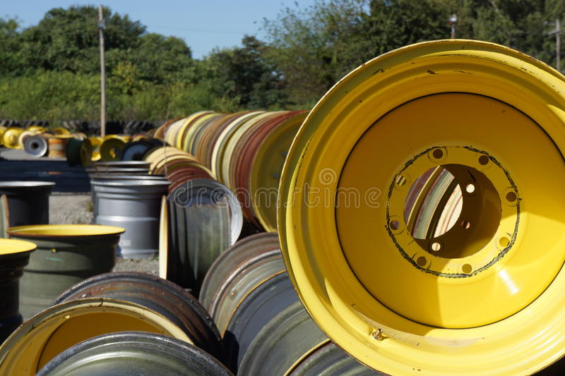 Industrial wheels in a long row. Industrial wheels stacked n a large supply yard stock photography