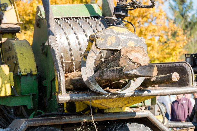 Industrial wood chipper in action stock image