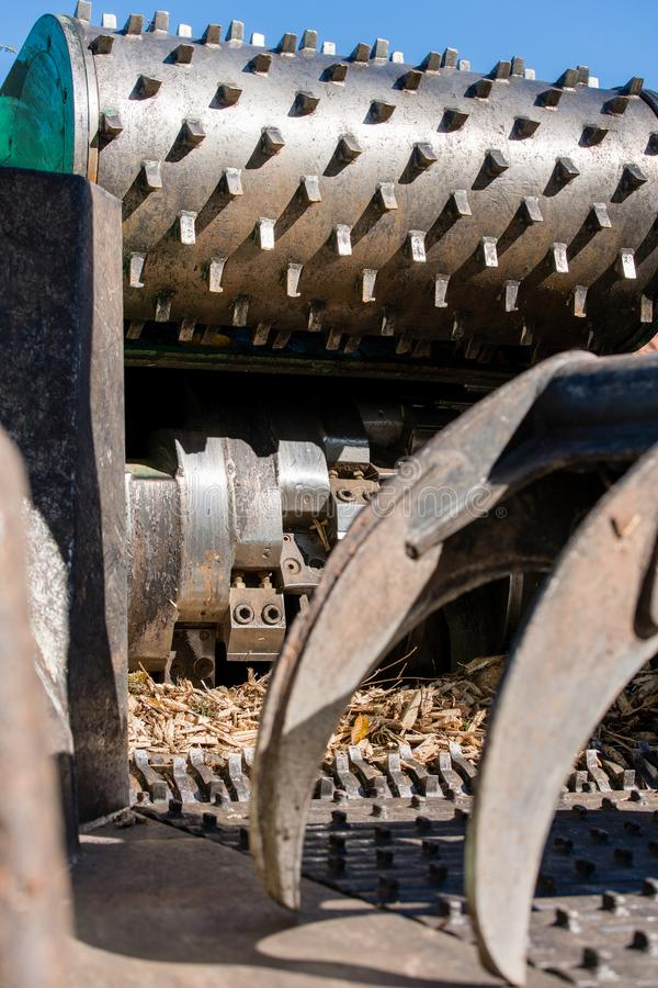 Industrial wood chipper in action royalty free stock photos