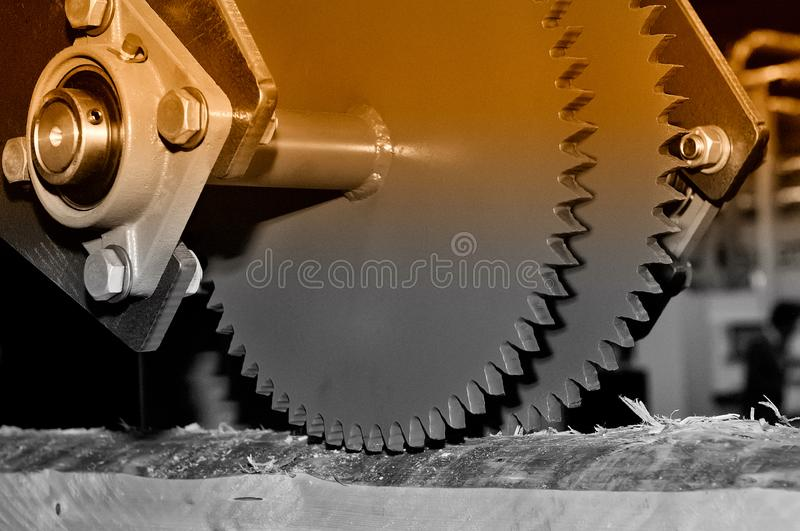 Industrial woodworking machine with circular saw disk. Brown toned. Industrial woodworking machine with circular saw disk. Milling machine for wood. Brown toned royalty free stock image