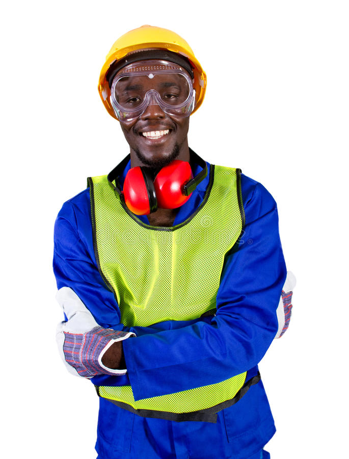 Industrial worker. A happy african industrial worker in full protective gear on white background royalty free stock photography
