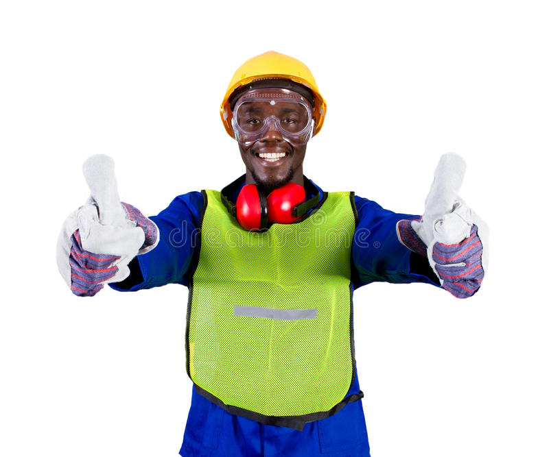 Industrial worker. A happy african male industrial worker with thumbs up on white background stock photos