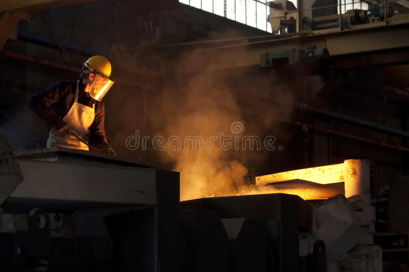 Industrial worker. Industrial heavy duty worker and smelting furnace royalty free stock photography