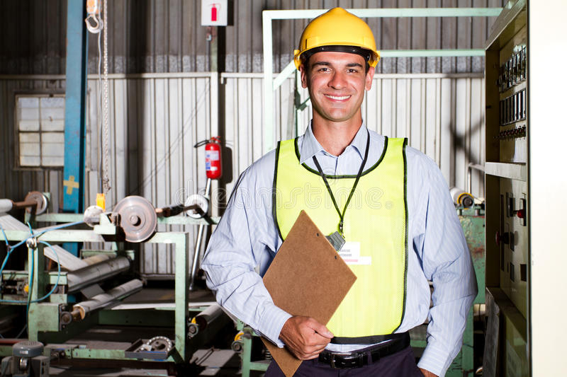 Industrial worker. Portrait of a happy male caucasian industrial worker in factory royalty free stock photo