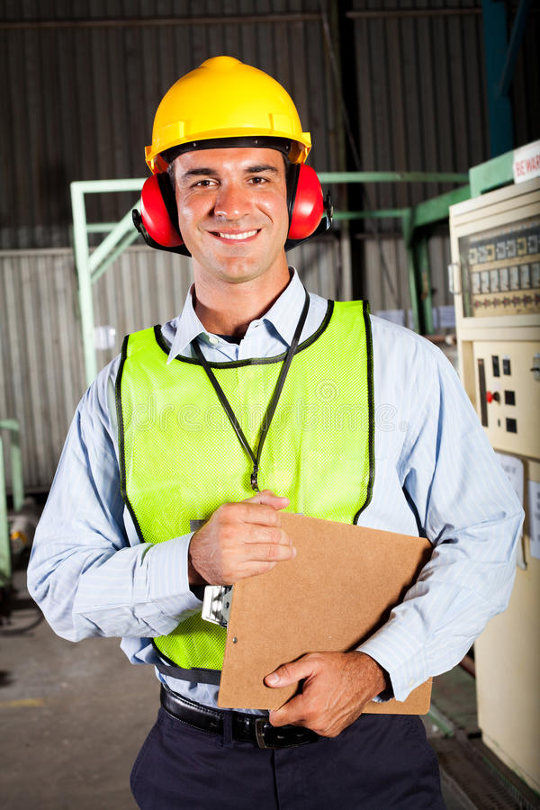 Industrial worker. Male industrial worker with personal protective equipment inside factory stock photos