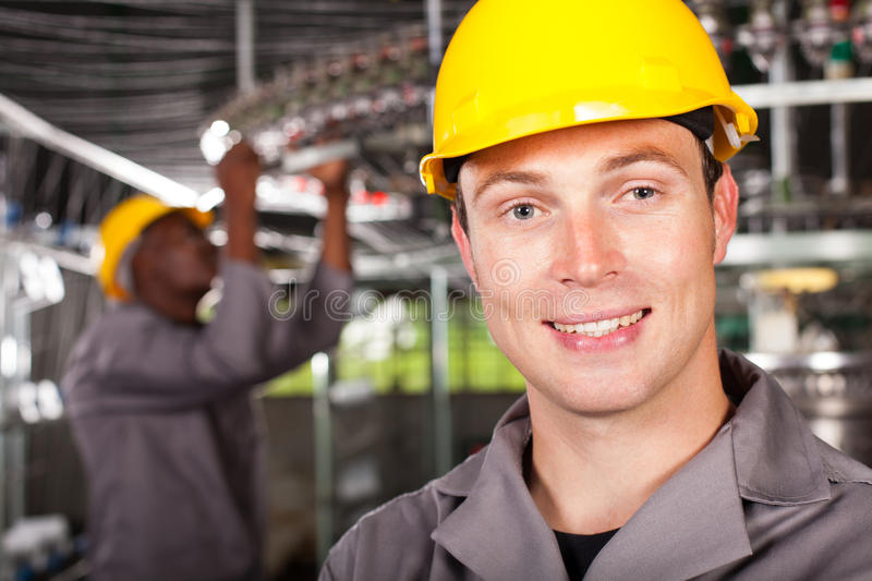 Industrial worker. Closeup portrait in factory royalty free stock photography