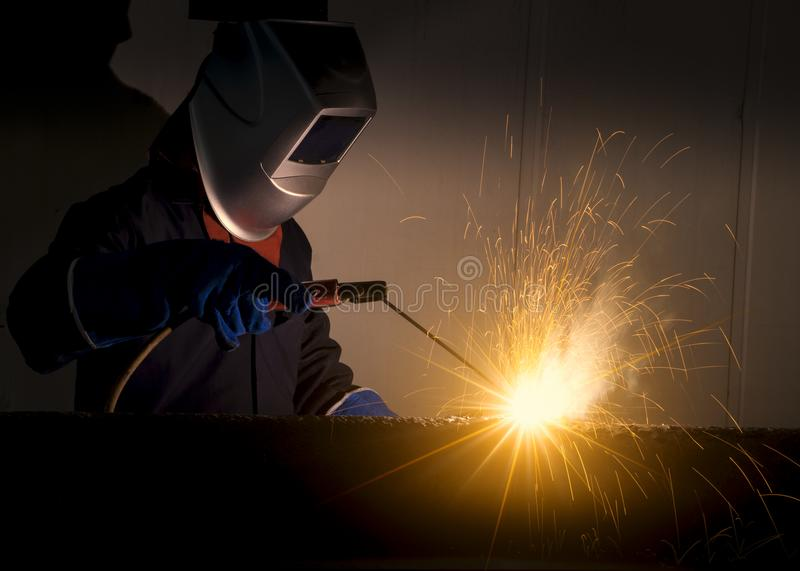 Industrial Worker at the factory welding closeup royalty free stock photos