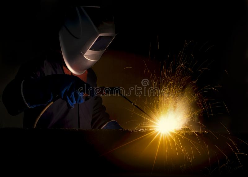 Industrial Worker at the factory welding closeup stock photos