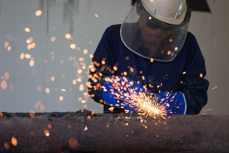 Industrial Worker at the factory welding closeup stock photography