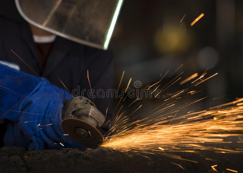 Industrial Worker at the factory welding closeup royalty free stock images