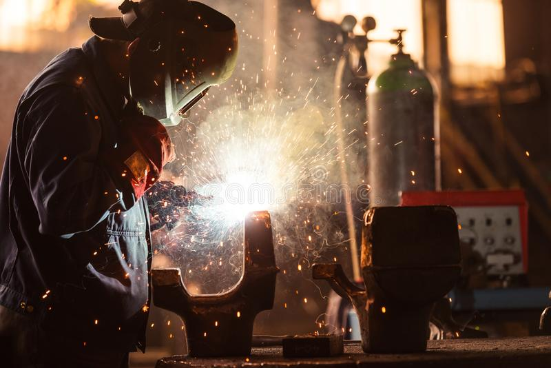 Industrial Worker at the factory. Welding closeup royalty free stock photos