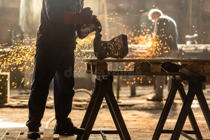 Industrial Worker at the factory. Welding closeup royalty free stock photography