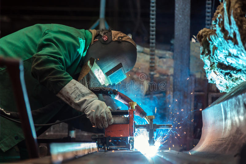 Industrial Worker at the factory. Welding closeup stock image