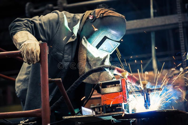 Industrial Worker at the factory. Welding closeup royalty free stock image