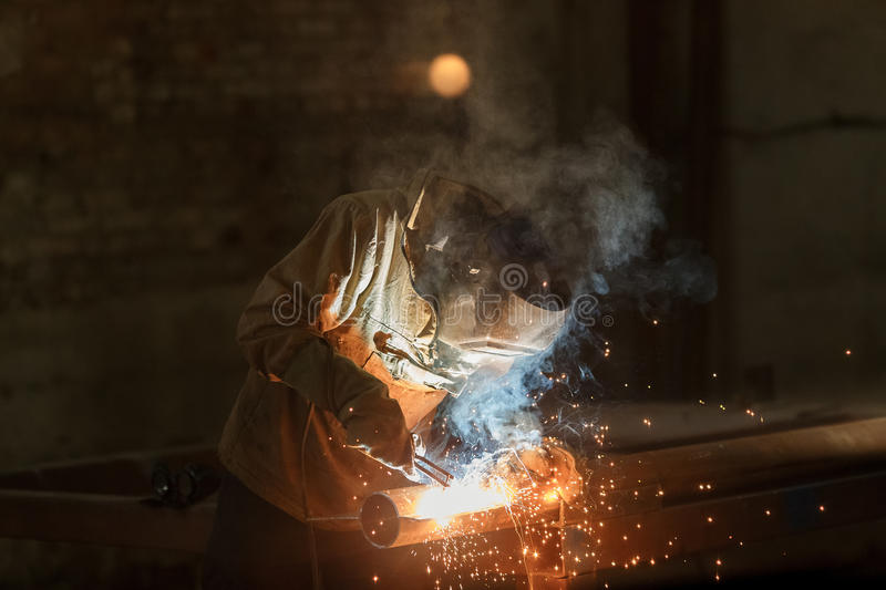 Industrial Worker at the factory welding closeup. royalty free stock photos