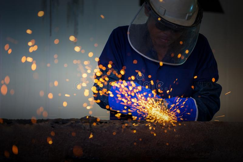 Industrial Worker at the factory welding closeup stock images