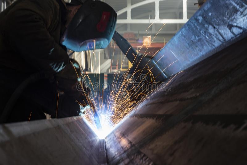 Long exposure Industrial Worker at the factory welding closeup sparks stock photos