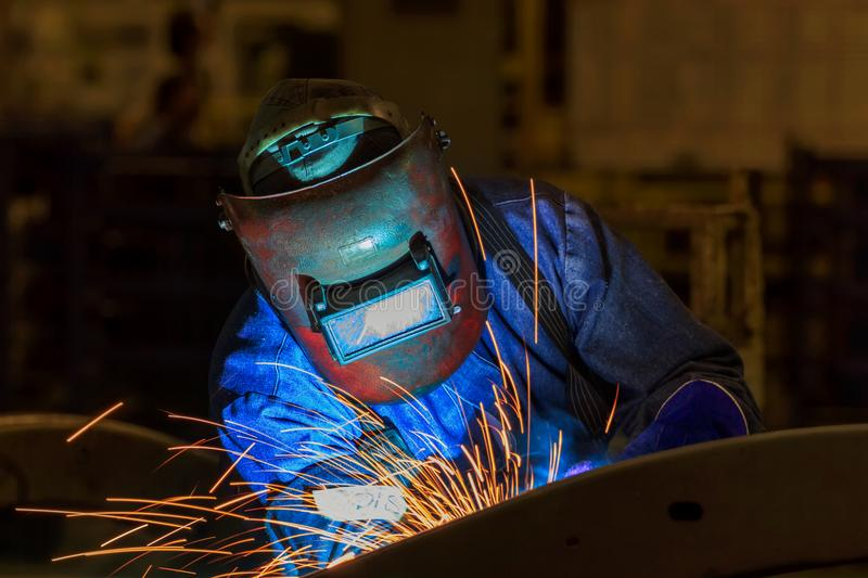 Industrial Worker at the factory welding closeup royalty free stock photography