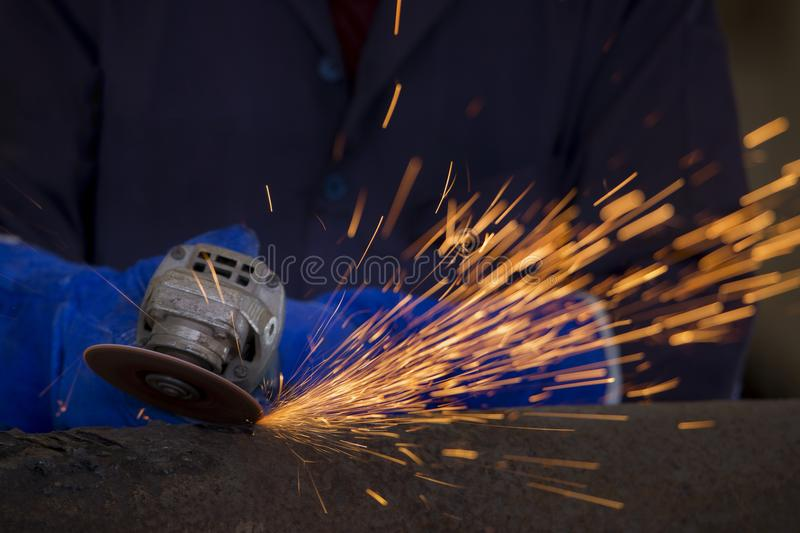 Industrial Worker at the factory welding closeup royalty free stock image
