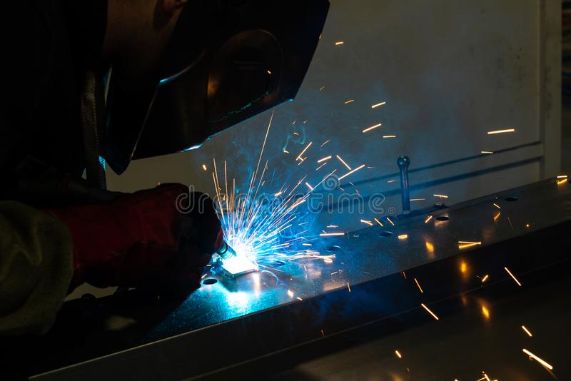 Industrial worker at the factory welding steel construction. Welder. Working stock images