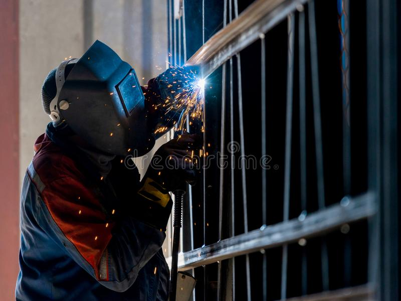 Industrial Worker labourer at the factory arc welding steel stru. Cture royalty free stock photography