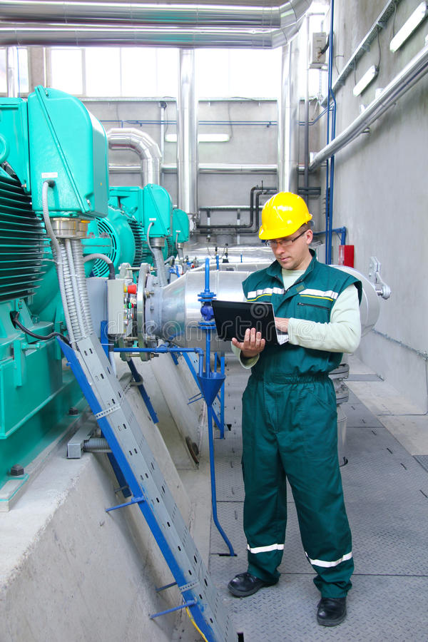 Industrial worker with notebook. In a factory stock images