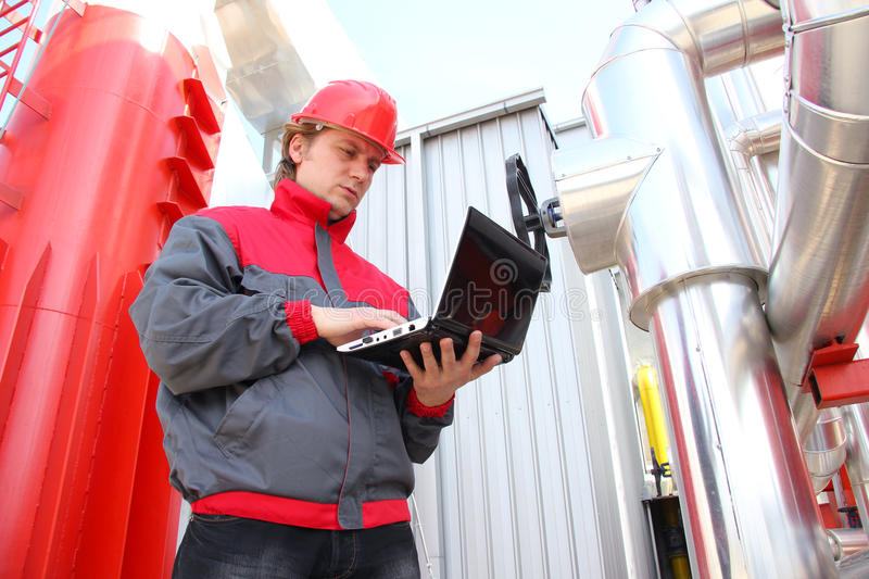 Industrial worker with notebook. Working in power plant royalty free stock image